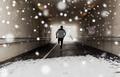 man running along subway tunnel in winter