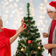 happy senior couple decorating christmas tree - PhotoDune Item for Sale