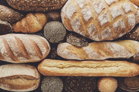 Bread background, top view of white, black and rye loaves - Stock Photo - Images