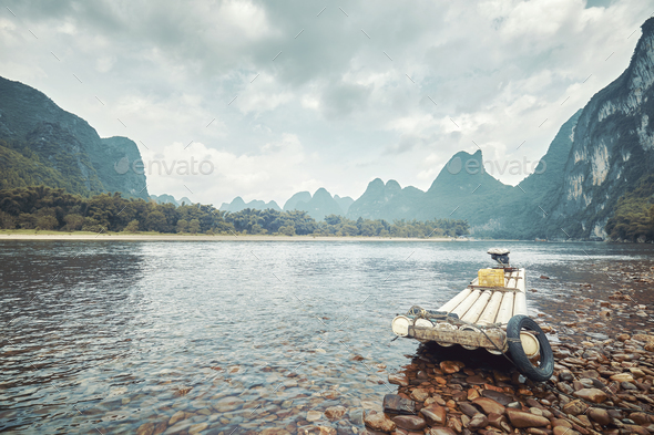 Retro toned picture of a bamboo raft on Li River, China. - Stock Photo - Images