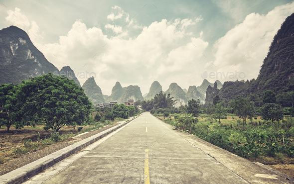 Retro stylized picture of a countryside road, China. - Stock Photo - Images