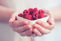 Crockery with raspberries in woman hands - PhotoDune Item for Sale