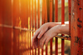 Female hands behind prison yard bars - PhotoDune Item for Sale