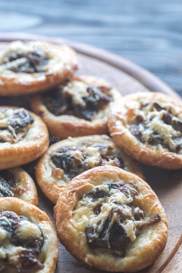 Tartelettes with shiitake mushrooms and cheese - Stock Photo - Images