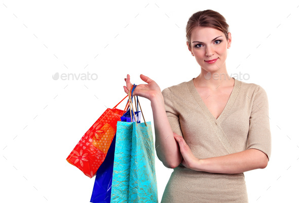 Portrait of a pretty young woman with shopping bags - Stock Photo - Images