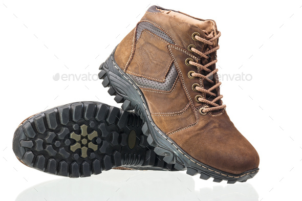 Pair of brown ankle-high men boots isolated over white - Stock Photo - Images