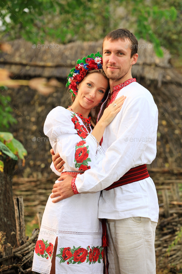 Lovely couple in Ukrainian style clothing outdoors - Stock Photo - Images