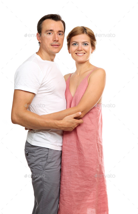 Portrait of an attractive loving couple looking at the camera - Stock Photo - Images