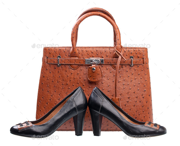Pair of black women shoes and terracotta handbag over white - Stock Photo - Images