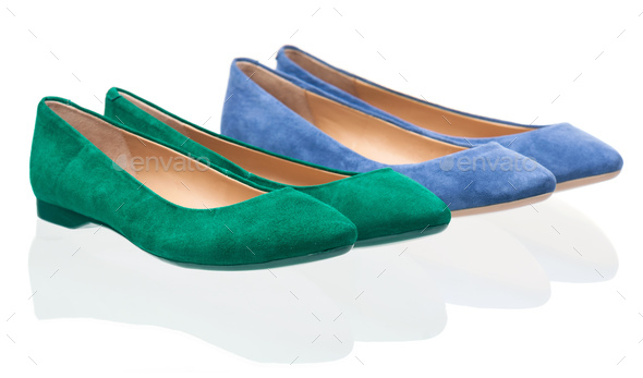 Pairs of green and blue pumps over white - Stock Photo - Images