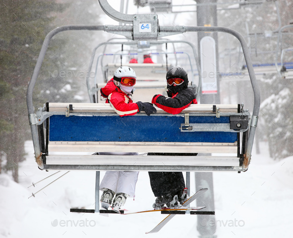 Skiers on a ski-lift - Stock Photo - Images