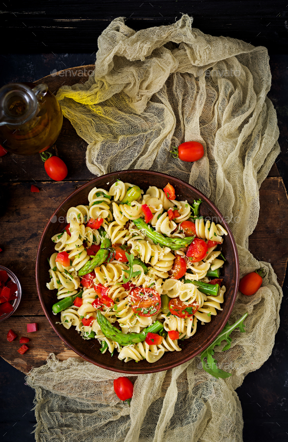 Salad - fusilli pasta with tomatoes, asparagus and sweet pepper - Stock Photo - Images