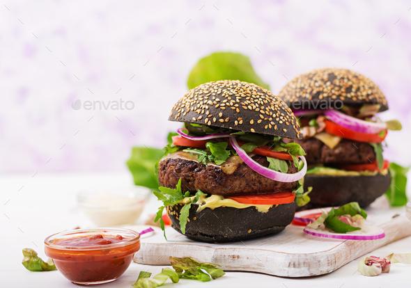Black big sandwich -  black hamburger with juicy beef burger - Stock Photo - Images