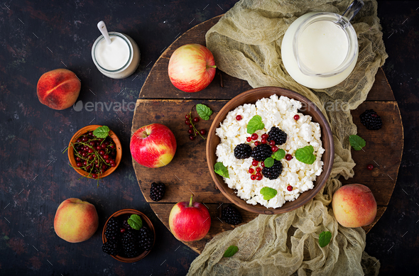 Cottage cheese with blackberries in a  bowl. - Stock Photo - Images