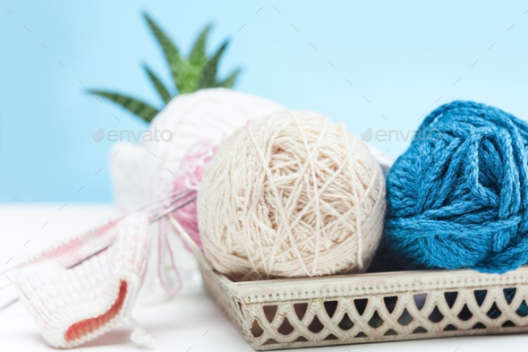The balls of wool on white wooden background - Stock Photo - Images
