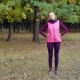 Beautiful Fitness Sport Girl Does Warm Up Before Running in Autumn Park - VideoHive Item for Sale