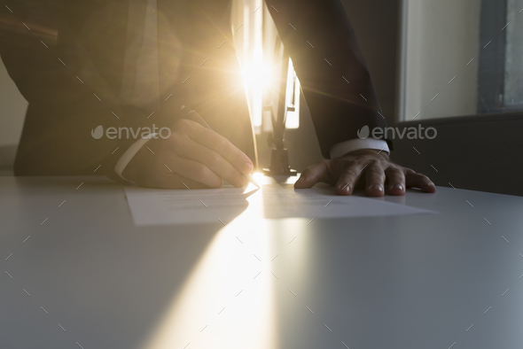 Businessman signing an important agreement - Stock Photo - Images
