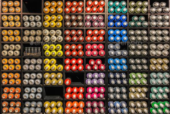Spray paint dispenser in rack - Stock Photo - Images