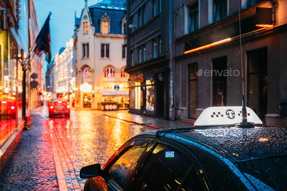 Taxi Car Wait Clients In Old European Streets  In Rainy Evening. - Stock Photo - Images