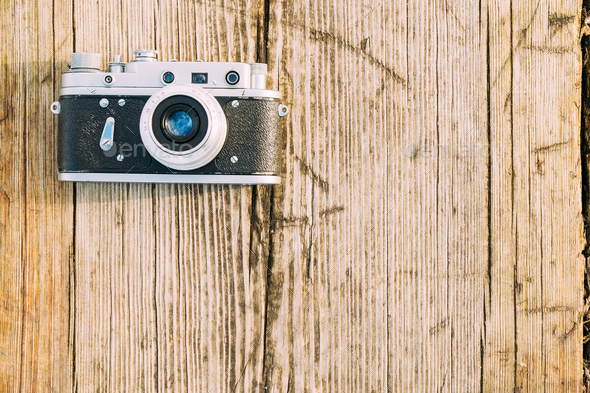 35mm Vintage Old Retro Small-Format Rangefinder Camera On Old Wo - Stock Photo - Images