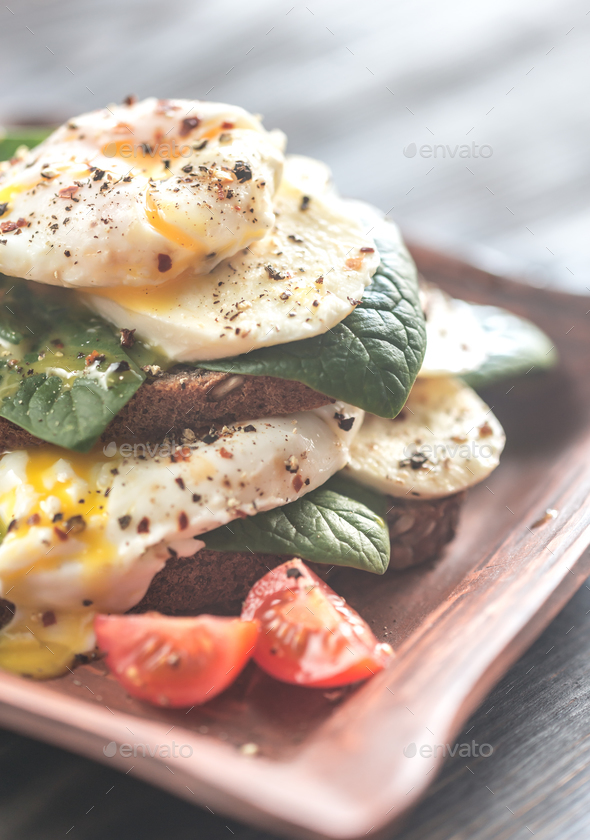 Tortilla sandwiches with poached eggs - Stock Photo - Images