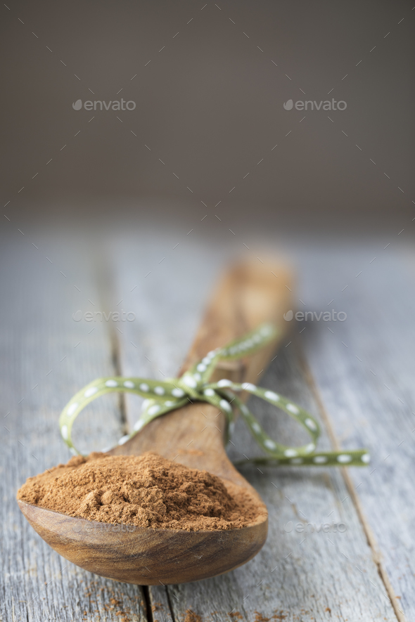 Cinnamon Powder in Wooden Spoon. - Stock Photo - Images