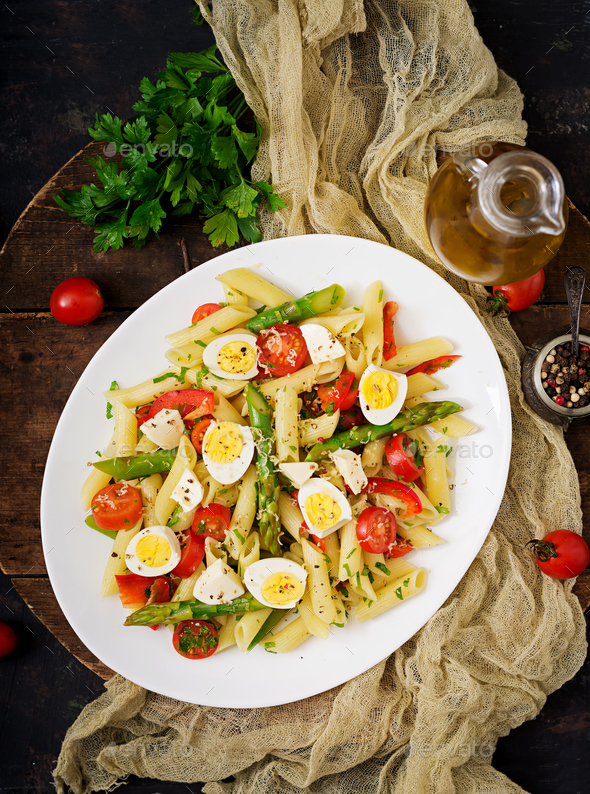 Salad - penne pasta with asparagus, tomatoes, quail eggs, mozzarella - Stock Photo - Images