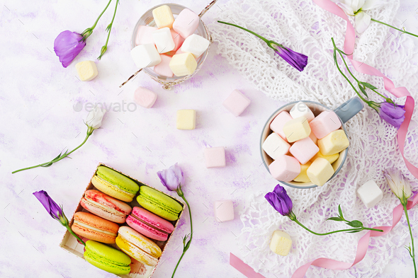 Colorful macaroons and marshmallows on a light background. Flat lay. Top view - Stock Photo - Images