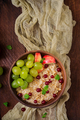 Delicious and healthy oatmeal with grapes, nuts and apples. Healthy breakfast