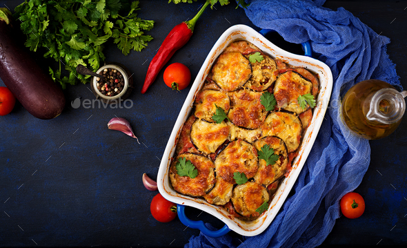 Eggplant Parmigiano (eggplant casserole) - a traditional Italian dish. Flat lay. Top view - Stock Photo - Images
