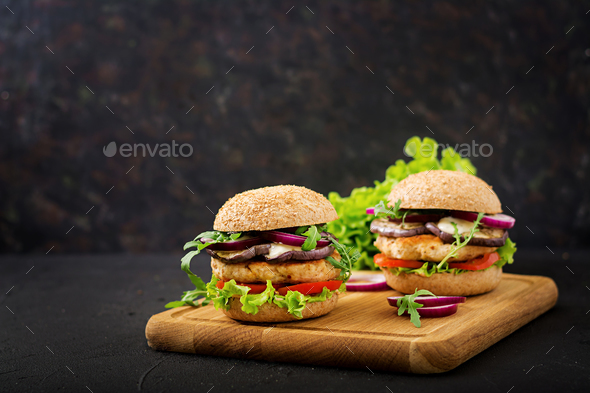 Sandwich juicy spicy chicken burgers with tomato and eggplant - Stock Photo - Images