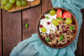 Delicious and healthy oatmeal with grapes, nuts, apples and cottage cheese.