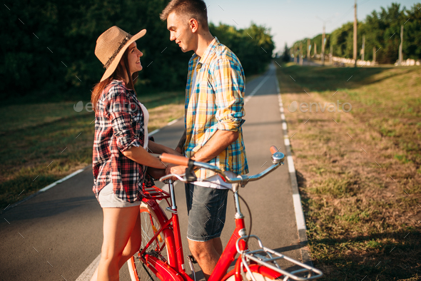 Love couple with vintage bicycle walking in park - Stock Photo - Images