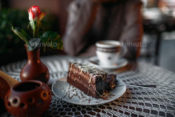 Delicious chocolate cake and a cup of coffee - Stock Photo - Images