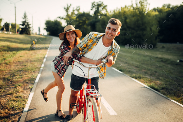 Love couple fun in summer park, vintage bicycle - Stock Photo - Images