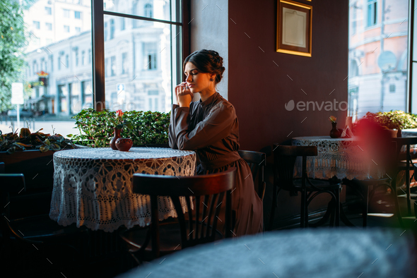 Young beautiful retro lady in cafe - Stock Photo - Images