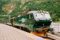 Flam, Norway. Famous Railroad Flamsbahn. Green Norwegian Train N