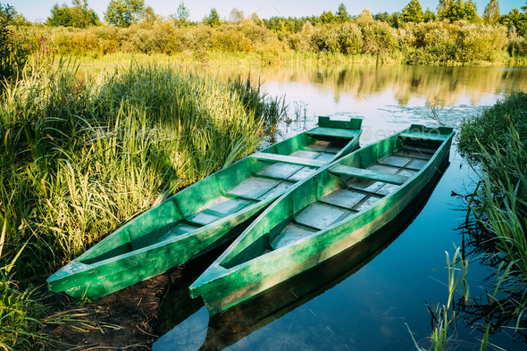 Lake Or River And Two Old Wooden Blue Rowing Fishing Boats At Be - Stock Photo - Images