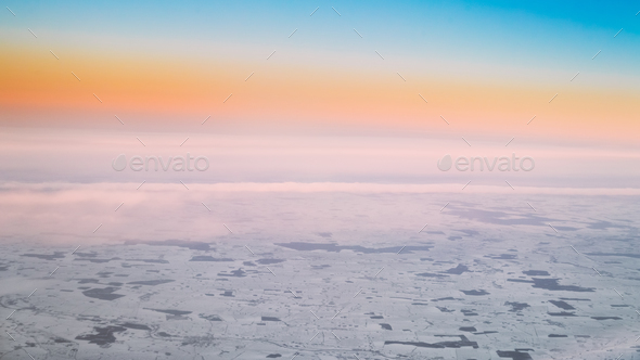 Aerial View From High Altitude Flight Of Aircraft On Snow-covere - Stock Photo - Images