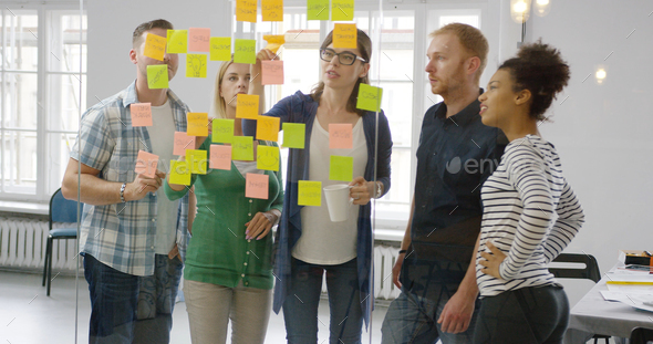 Colleagues working together in modern office - Stock Photo - Images