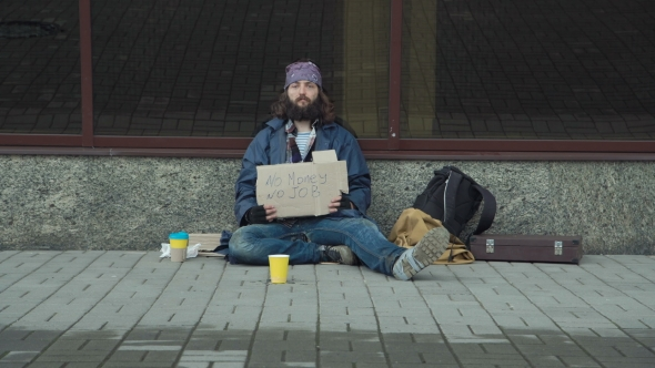 VideoHive Homeless with Cardboard on Street 20819141