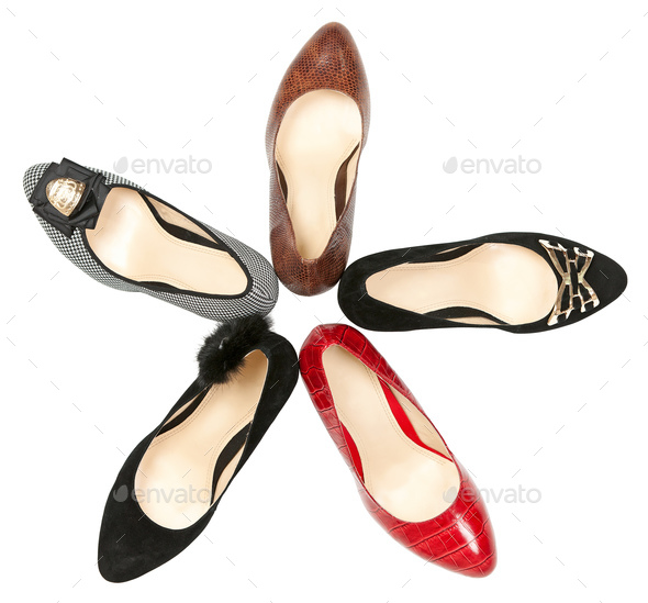 Women shoes in circle over white background - Stock Photo - Images