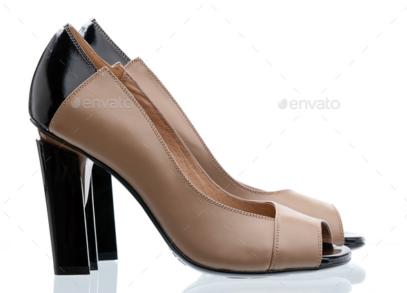 Pair of open-toe women shoes isolated over white - Stock Photo - Images