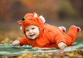 Baby boy dressed in fox costume