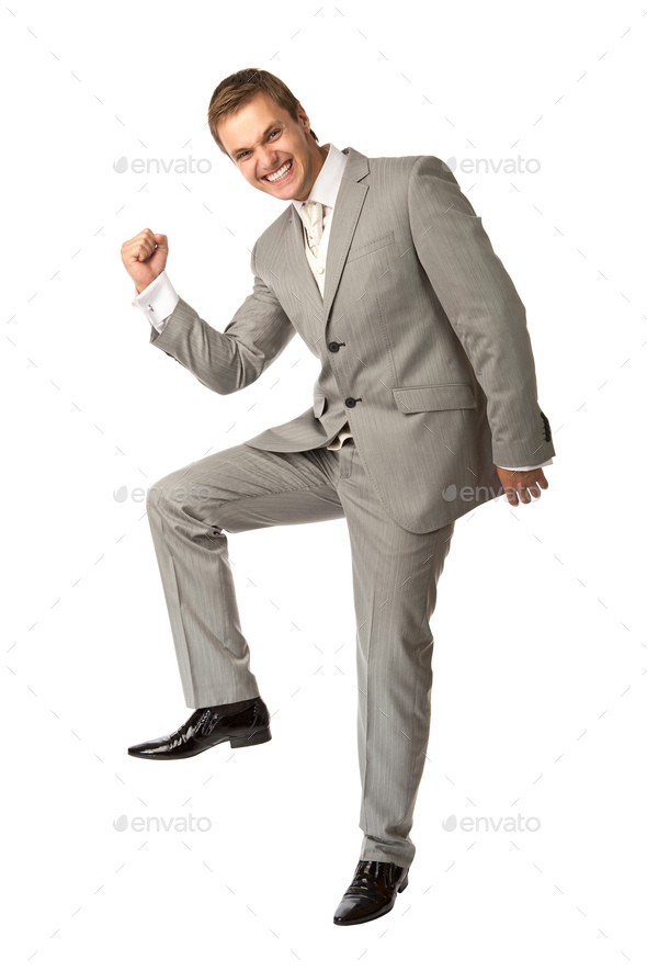 Cute young guy in suit clenching his fist in triumph - Stock Photo - Images