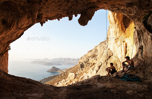 Two rock climbers having a rest. Kalymnos Island, Greece - Stock Photo - Images