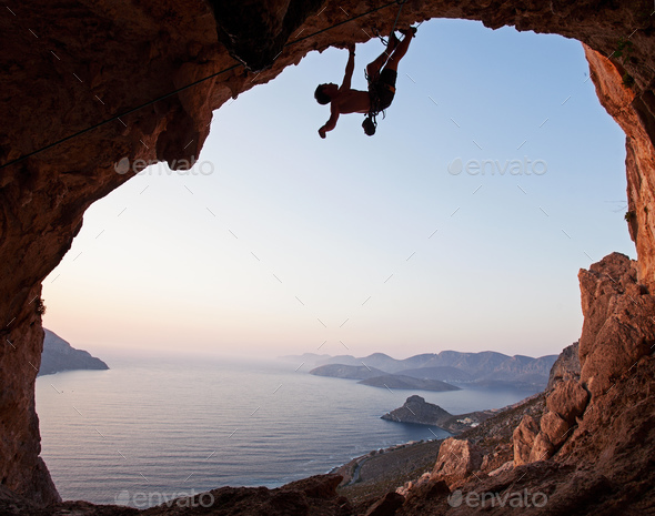 Silhouette of a rock climber at sunset, Kalymnos Island, Greece - Stock Photo - Images