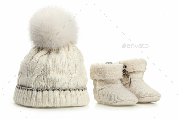 Warm woolen baby hat and booties over white - Stock Photo - Images
