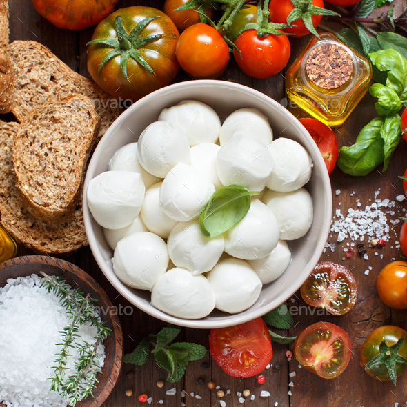 Italian cooking ingridients and mozzarella - Stock Photo - Images