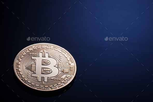 Golden bitcoin on a dark blue background - Stock Photo - Images